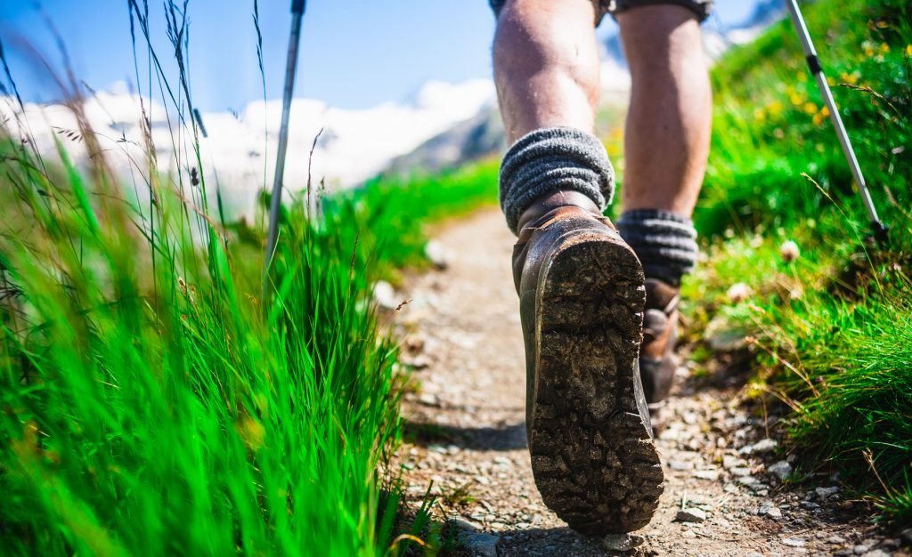 Hiker on mountain trail, Close-up.