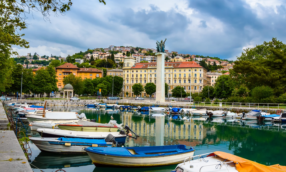 Rijeka, Croatia: Rjecina river with Liberation Monument, boats and view over the city and Trsat castle